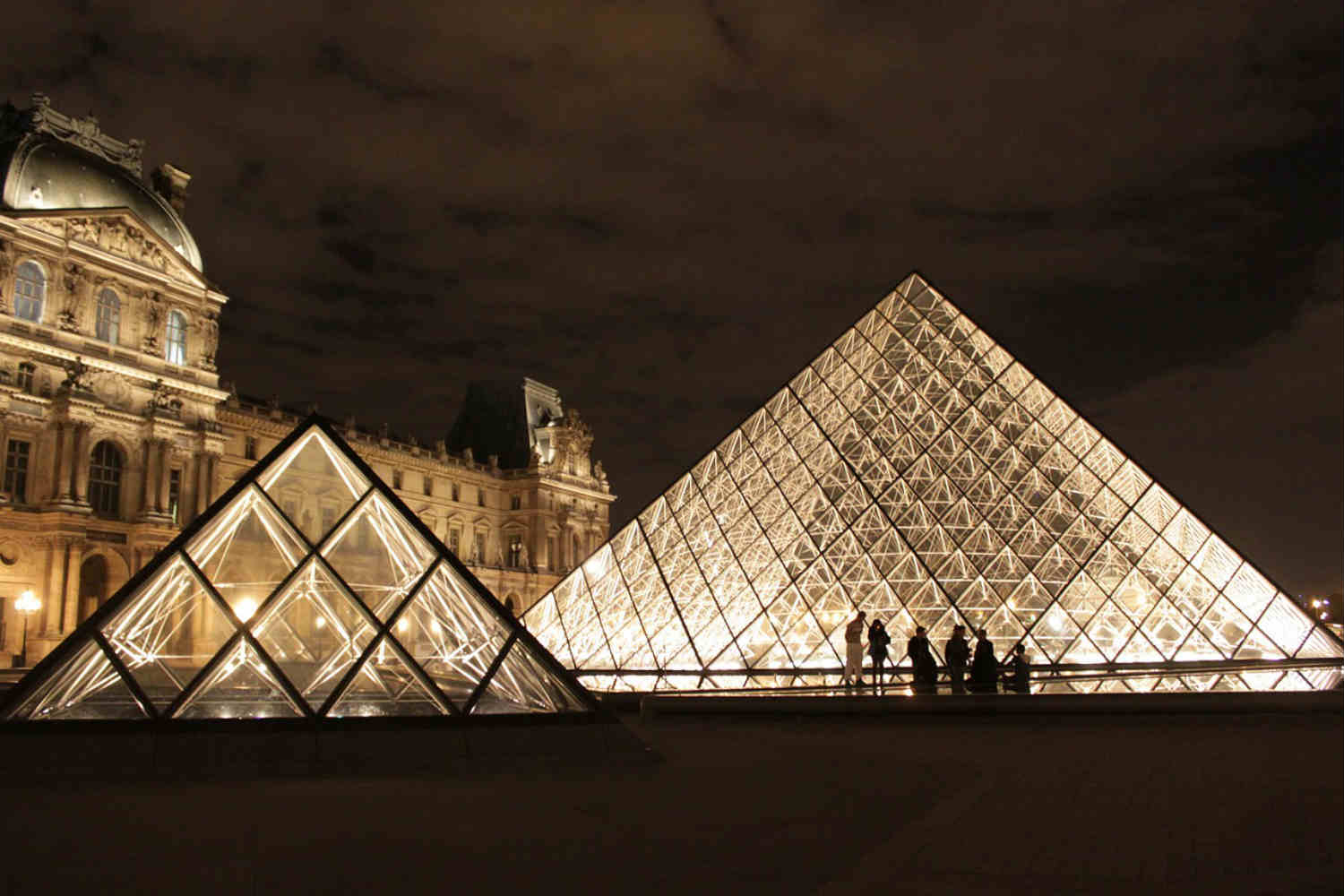 the louvre glass pyramid at night